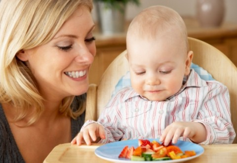 Baby eating finger foods